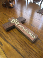 Pretty Believe wood sign on wood grain table