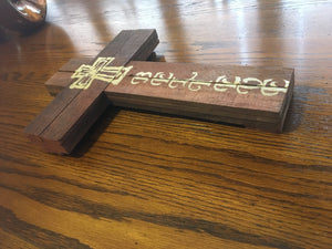 Believe wood sign on table