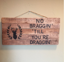 hunting pallet sign hanging on wall
