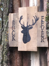 Buck Fever pallet sign in lightning strike of tree
