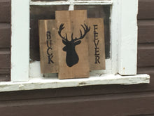 Buck Fever Pallet sign in window of barn