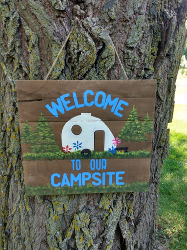 camping sign on tree