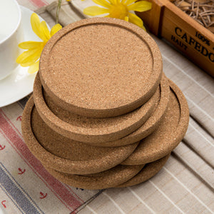 Wood coasters with cork-stacked on table