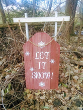 Let it snow pallet sign in leaves