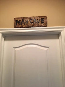 Man cave sign over man cave door