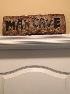 close up of Man Cave sign