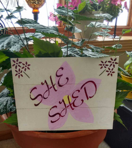 She Shed pallet sign on pot close up