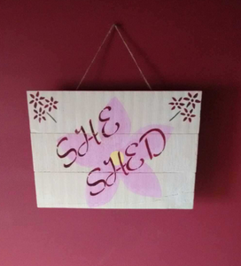 She Shed sign on pink wall