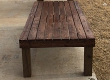 treated wood bench absorbs stain differently