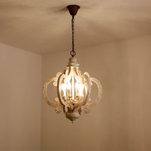 Victorian distressed wood chandelier-hanging at night