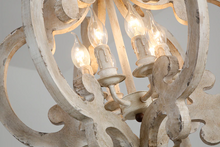 Victorian distressed wood chandelier-close up of lights