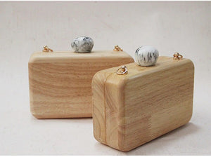 2 wooden clutches