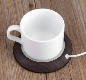 dark wood cup warmer with plugin