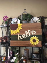 sunflower sign with full shelf