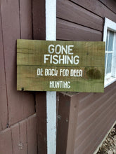 Gone fishing sign hanging on shed