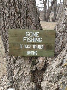 Gone Fishing sign in crook of tree
