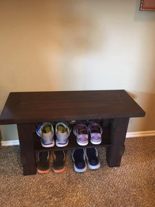 entryway bench with shoes showing