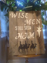 wise men pallet sign on table near pot
