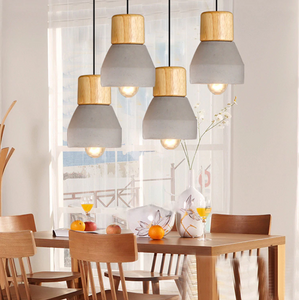 all same color pendant lights over kitchen table