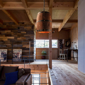 oak barrel lights hanging over wood flooring