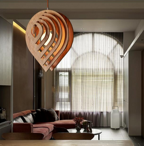 wood pendant light hanging in LR