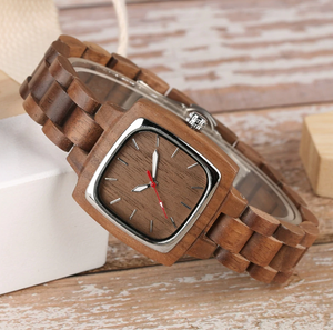 his and her wood watches-tilted on shelf