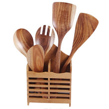 wood spoons in holder