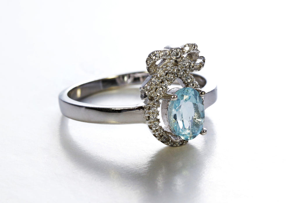Aquamarine Ring with Ribbon Accent