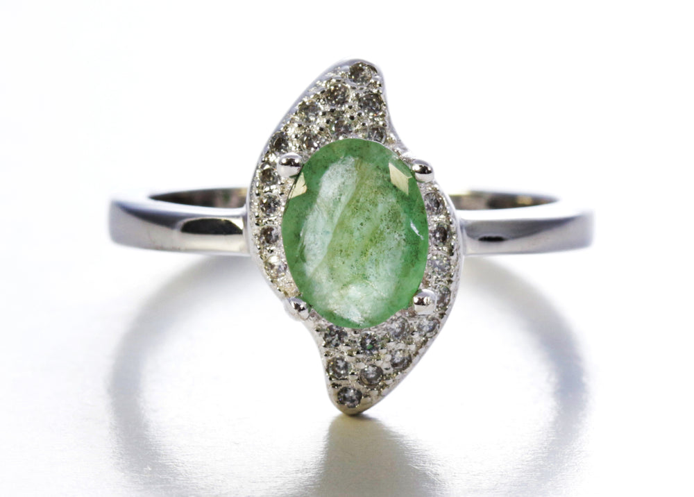 Oval Peridot with Cubic Zirconia Accents in Sterling Silver