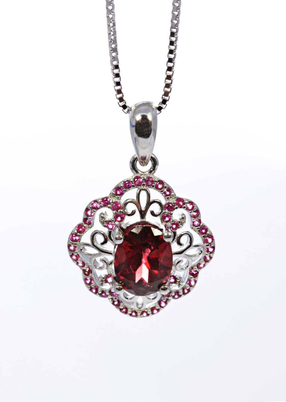 Oval Garnet Pendant with Ruby Accents in Sterling Silver
