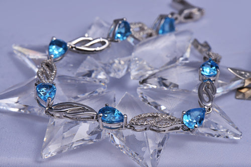 Bracelet With Blue Topaz & 5A Cubic Zirconia In Sterling Silver