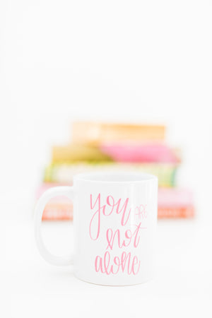 Full Heart Co's Hand-Lettered You Are Not Alone mug. 10% of each sale is donated to The Lauren Scruggs Kennedy Foundation. Be encouraged + give back at the same time. This cute coffee mug is a great reminder that you are truly not alone. Buy it for yourself or a friend. Your coffee mug rack needs this cute and encouraging addition.