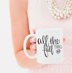Full Heart Co's Hand-Lettered All The Fall Things mug. Celebrate your love for fall and pumpkin with this fall mug. Gift it for yourself or a friend. This fall mug makes the perfect addition to your fall coffee mug rack.