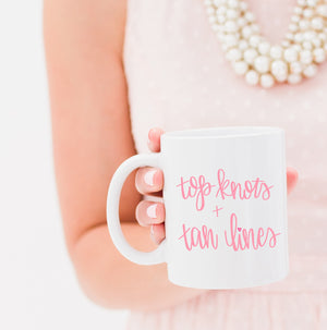 Full Heart Co's Hand-Lettered Top Knots and Tan Lines mug. The perfect gift for the beach lover. Gift it for yourself or a friend. Your coffee mug rack needs this cute addition.