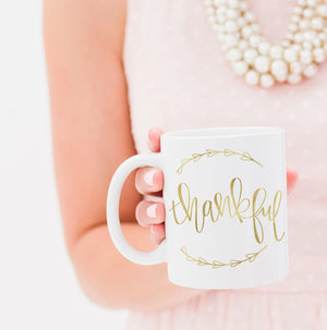 Full Heart Co's Hand-Lettered Thankful mug.  Buy it for yourself or a friend. This mug is a great way to remind yourself every single day of all that you have to be thankful for. Your coffee mug rack needs this cute and encouraging addition.