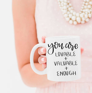 Full Heart Co's Hand-Lettered Lovable, Valuable + Enough mug. This cute coffee mug is a great reminder that you are truly lovable, valuable + enough. Buy it for yourself or a friend. Your coffee mug rack needs this cute and encouraging addition.