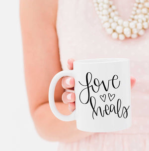 Full Heart Co's Hand-Lettered Love Heals mug. 10% of each sale is donated to Cure International. Be encouraged + give back at the same time. Buy it for yourself or a friend.