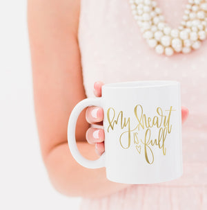 Full Heart Co's Hand-Lettered My Heart Is Full mug.  Buy it for yourself or a friend. This mug is a great way to remind yourself every single day of all the reasons your heart is full. Your coffee mug rack needs this cute and encouraging addition.