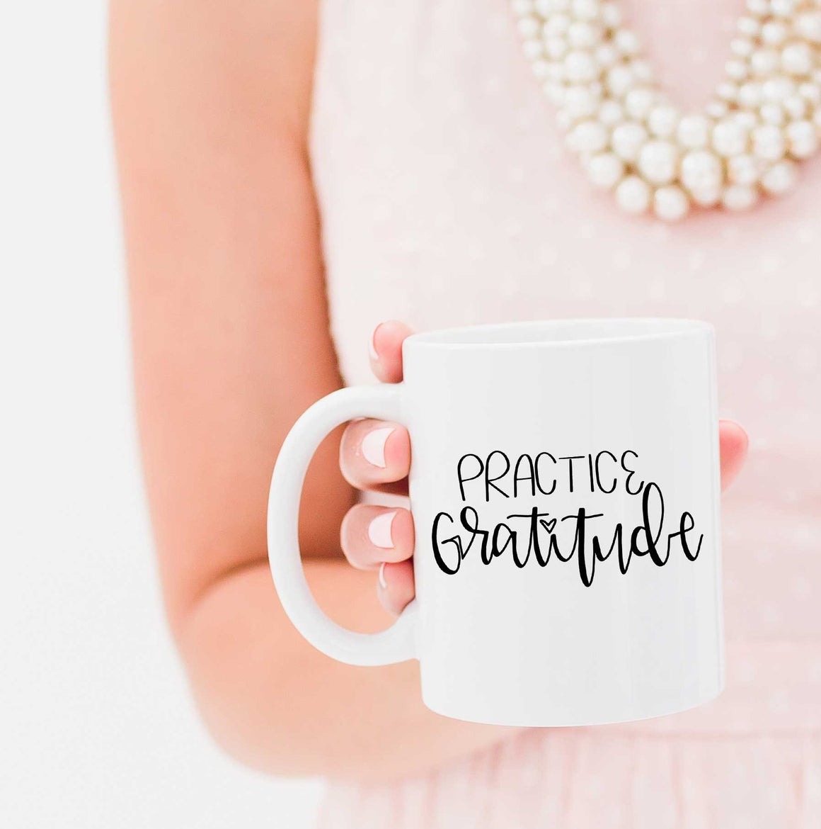 Full Heart Co's Hand-Lettered Practice Gratitude mug. Remember to practice gratitude every morning with this coffee mug. Buy it for yourself or a friend. This mug makes the perfect addition to your fall/thanksgiving coffee mug rack.