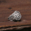 Adjustable viking wolf ring on a wooden table