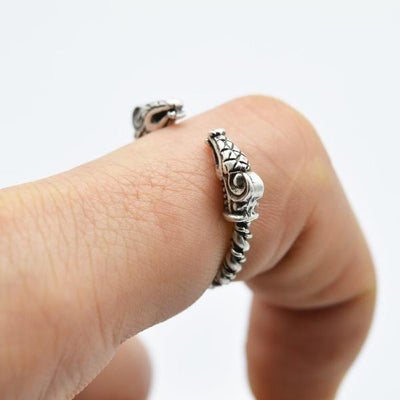 adjustable viking dragon ring on a model's finger