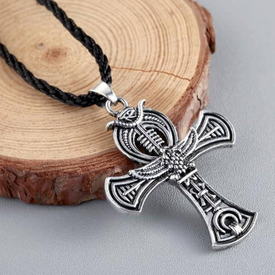 Celtic  Cross Irish Druid Pendant next to a tree stump