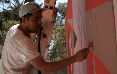 Neslon Rivas working on one of his art pieces