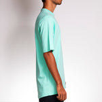 Side view of Crew Shirt Mint, by Holystoked, worn by a skateboarder from Bangalore.