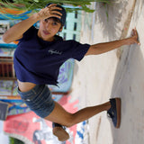 Bgirl wearing Flexi Blue T-shirt by Holystoked at the Cave Skatepark.