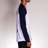 Side view of Poser Navy t-shirt by Holstoked, worn by a male skateboarder.