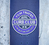 Close up shot of Film Trucks Curb Club griptape on Lurk Street Cruiser Skateboard Complete by Holystoked