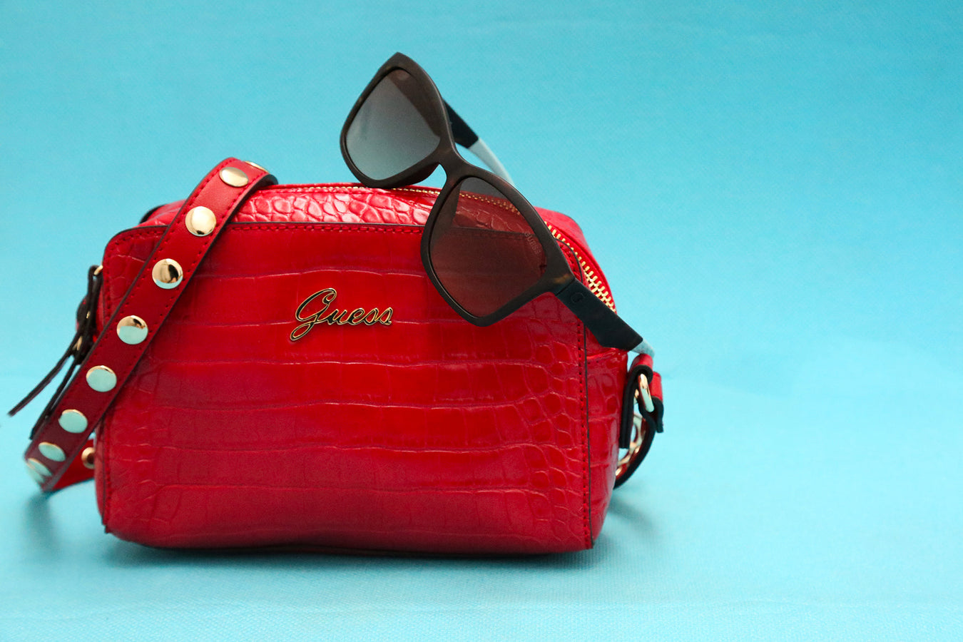 Guess womens cross body bag in red & sunglasses in red