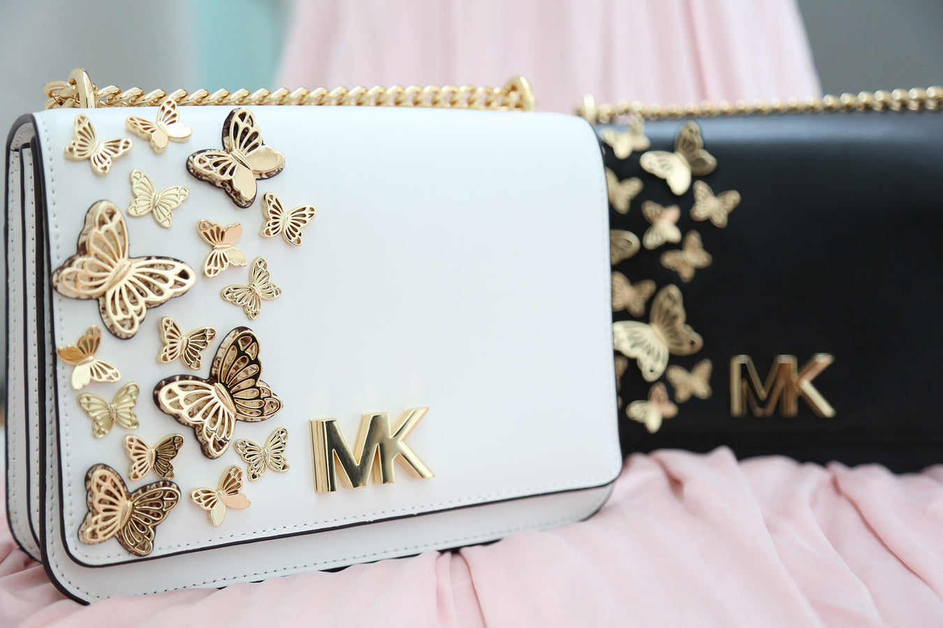 Michael Kors leather cross body bag with butterfly applique in white & black
