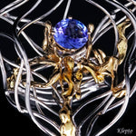 White gold ring with Tanzanite and yellow gold details